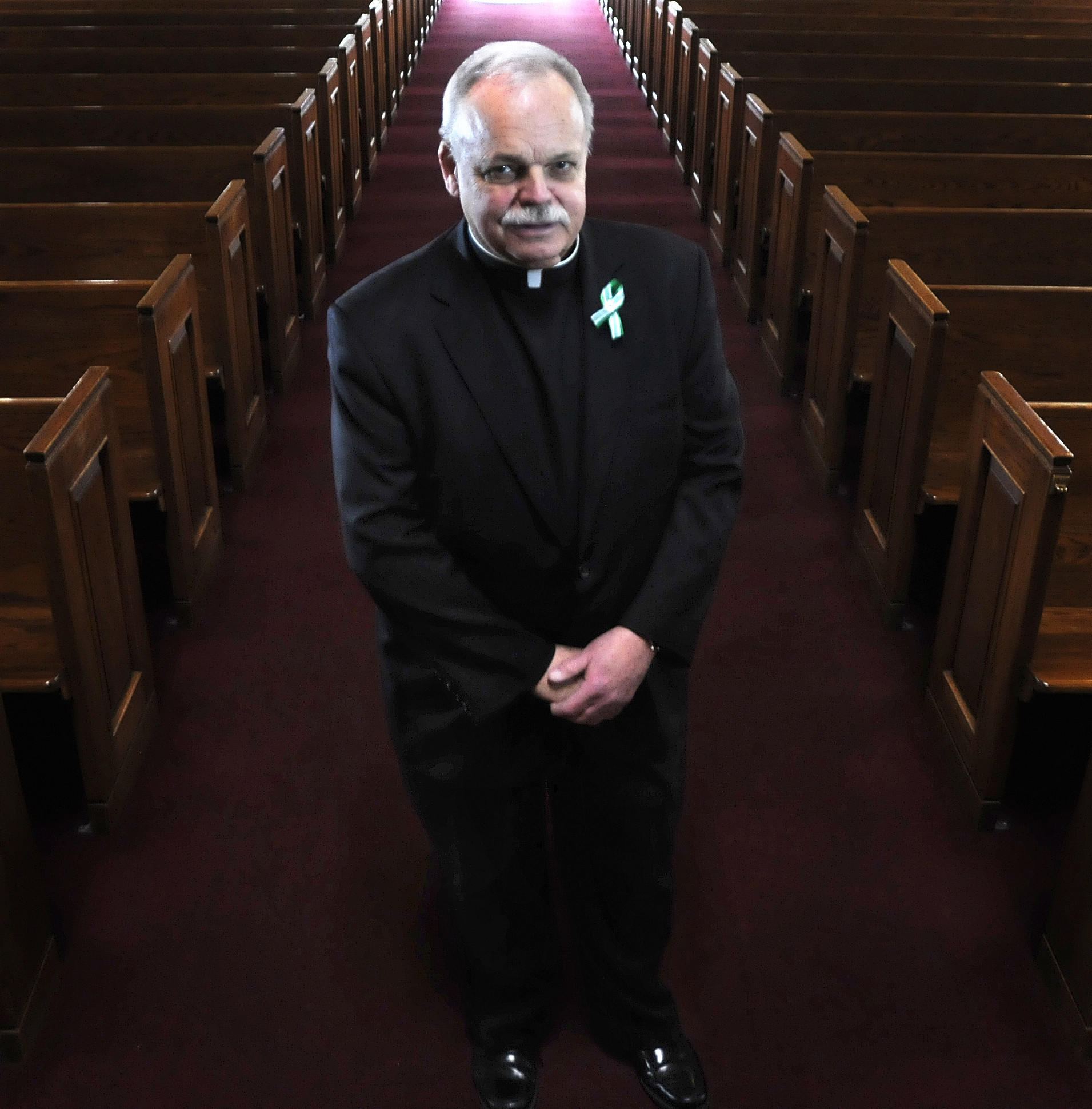 "As he stood near the front door of the Sandy Hook Elementary School on the morning of Dec. 14, shattered glass near his feet, Monsignor Robert Weiss knew he was as close to evil as he would ever get.  He said a prayer for the dead near the front entrance and then went back up to the nearby firehouse. It was then that Father Bob, as he is known to almost everyone in the tight-knit community, began to realize the enormity of the tragedy facing the families of the dead and the town itself. The night of the shooting at an impromptu memorial service he told the crowd, ""evil visited us but we have to get through it and find some good.""  It became a theme for the town. Variations of what Weiss said that night about ""choosing good"" are now on bumper stickers, signs and logos."