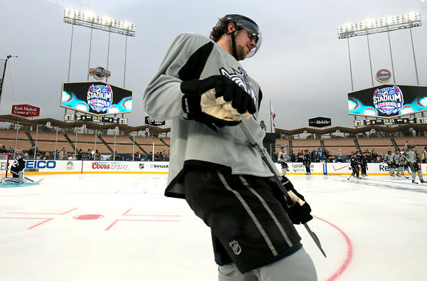 Center Anze Kopitar joins the Kings as they skate for the first time on the ice rink at Dodger Stadium on Friday night.