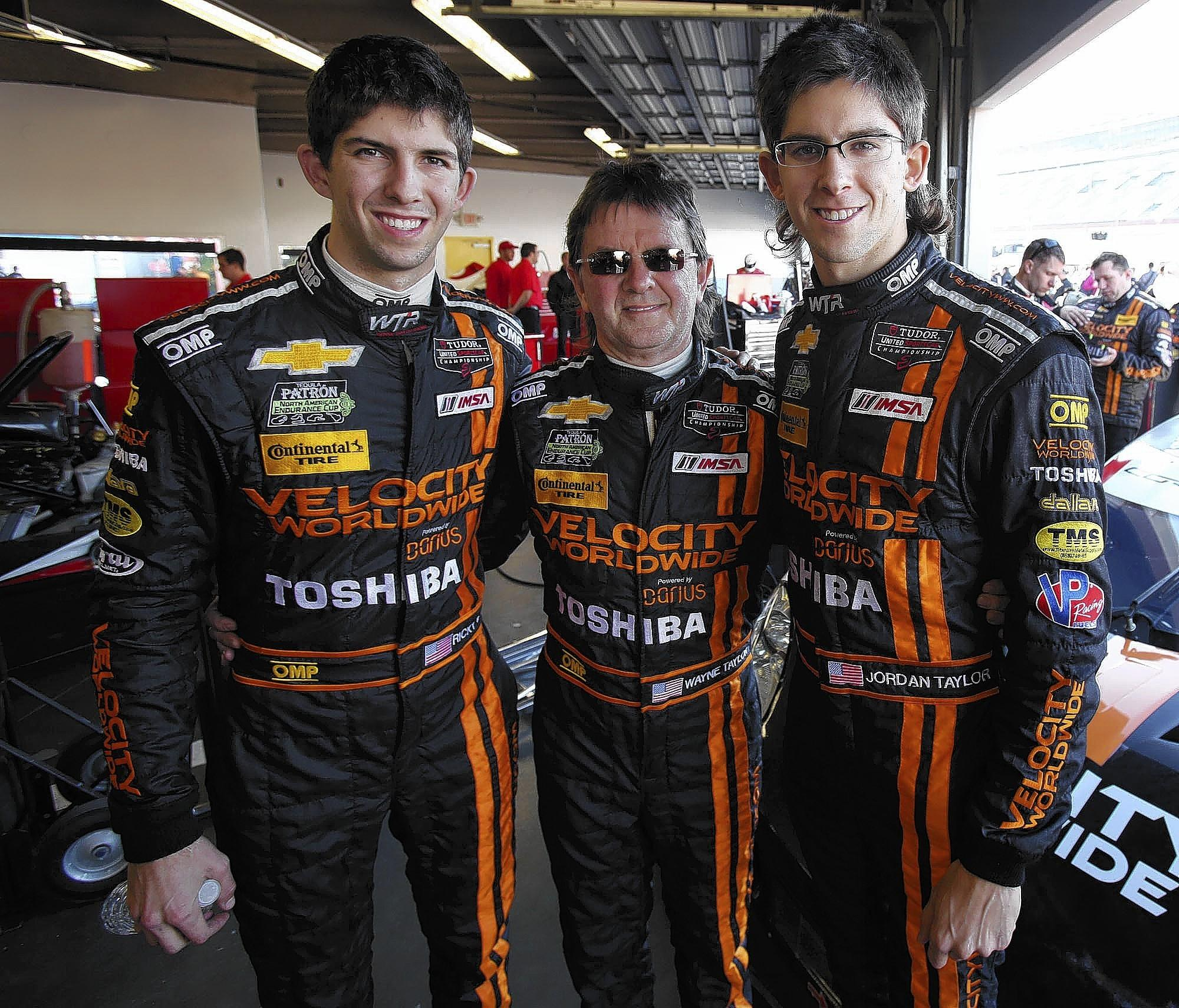Wayne Taylor, middle, is pictured with his sons, Ricky, left, and Jordan in the garage area before qualifying for the Rolex 24 at Daytona International Speedway on Thursday.
