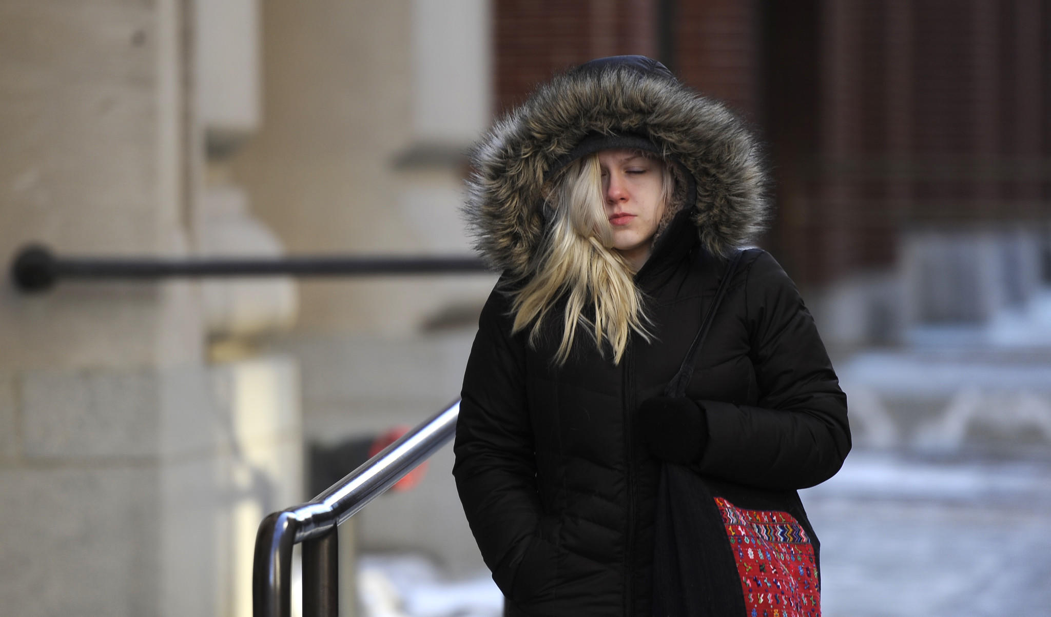 Andrea Janofsky of Baltimore is bundled up as she walks to work along Redwood Street downtown.