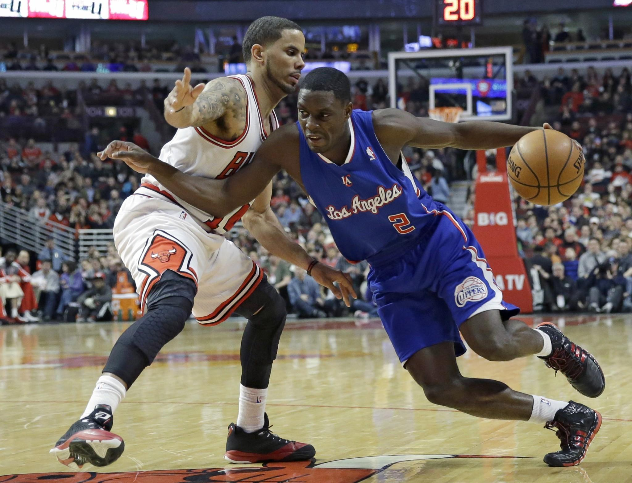 Darren Collison drives against Chicago's D.J. Augustin during the first half of the Clippers' 112-95 win Friday over the Bulls. Collison had 17 points with four assists.