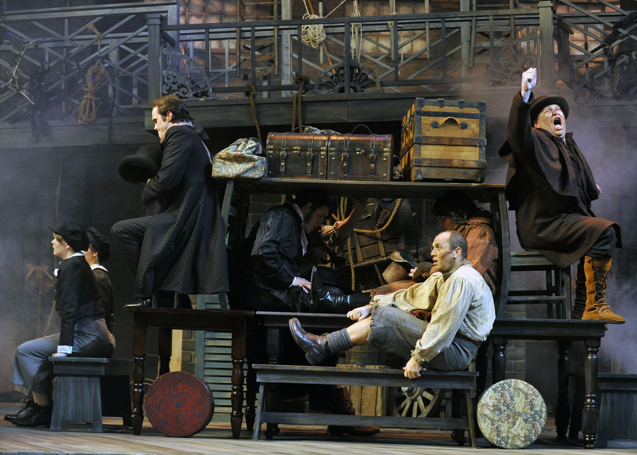 "Items on the stage form a carriage in ""The Life and Adventures of Nicholas Nickleby."""