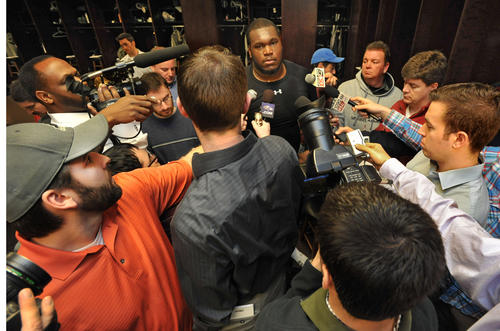 Offensive lineman Kelechi Osemele speaks to a group of reporters in the Ravens locker room.