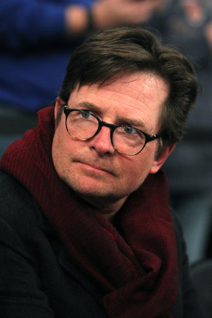 American actor Michael J. Fox sits court side before the start of a game between the New York Knicks and the Miami Heat at Madison Square Garden.