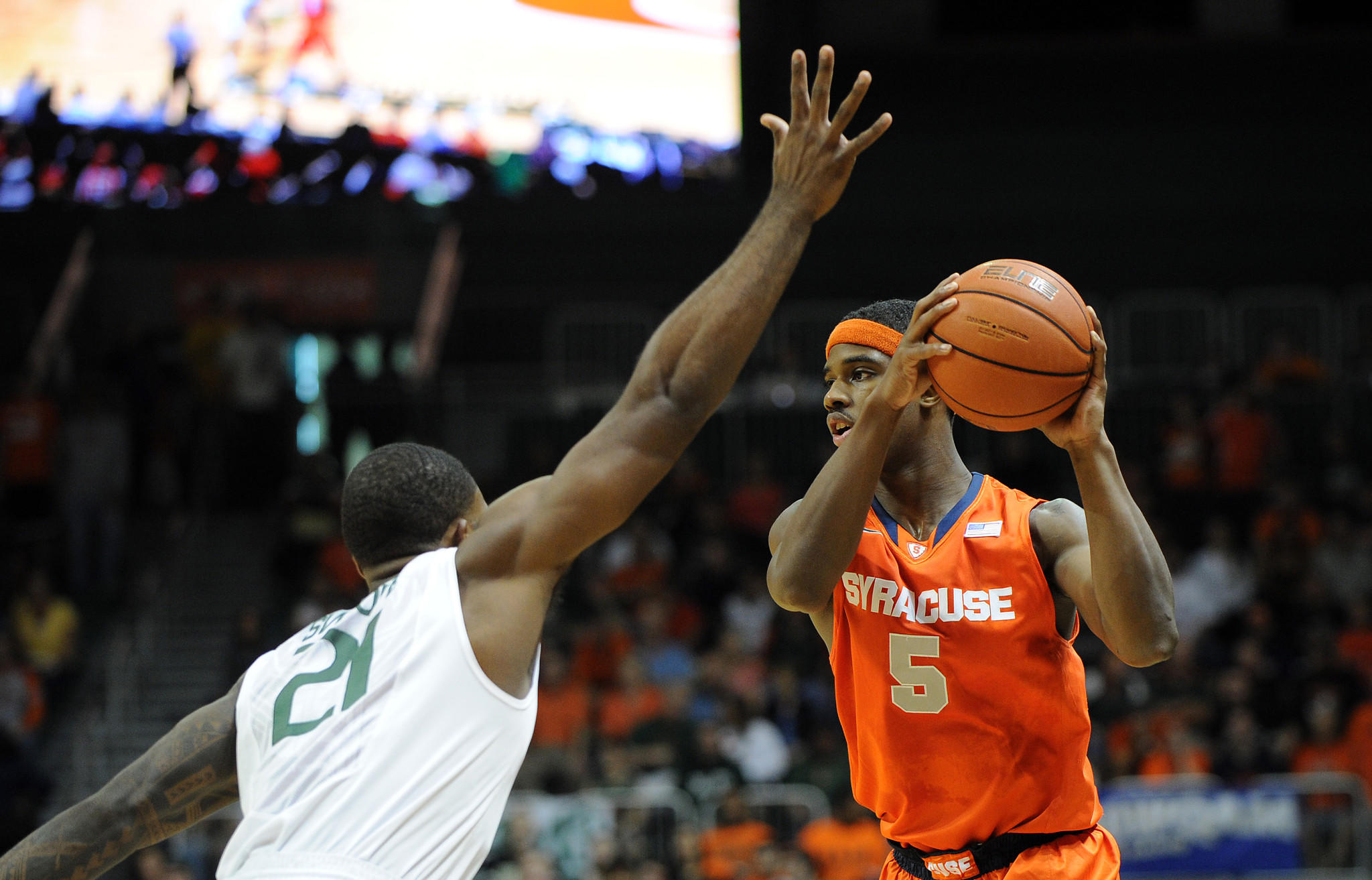 Syracuse Orange forward C.J. Fair (5) is pressured by Miami Hurricanes forward Erik Swoope (21) during the first half at BankUnited Center.
