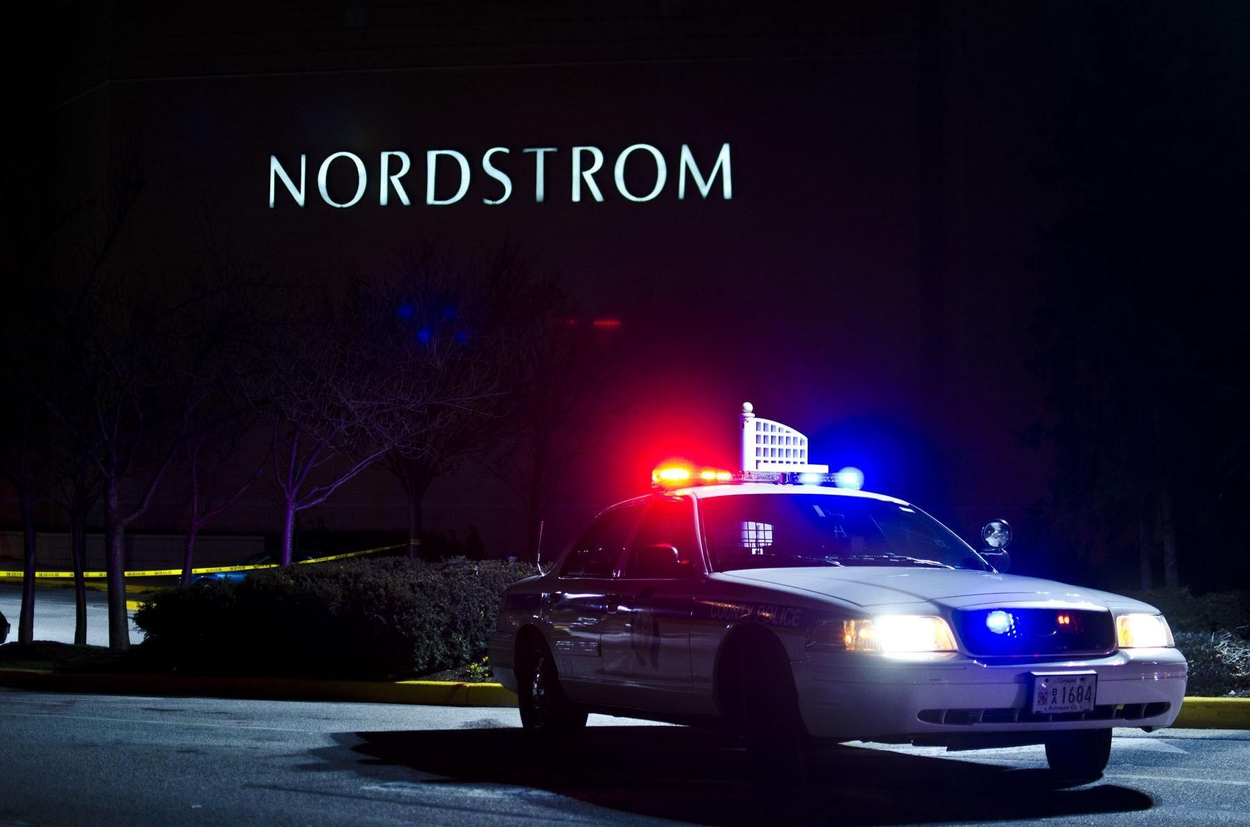 A Baltimore County Police cruiser blocks the entrance to Nordstrom at Towson Town Center, Monday, Dec. 19. after a 19-year-old Baltimore man was fatally shot just after 6 p.m. outside the service entrance of Nordstrom.