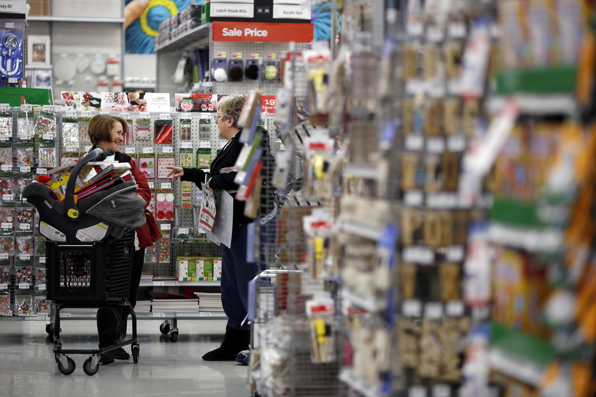 Customers chat while shopping at a Michaels craft store in Cincinnati in December.