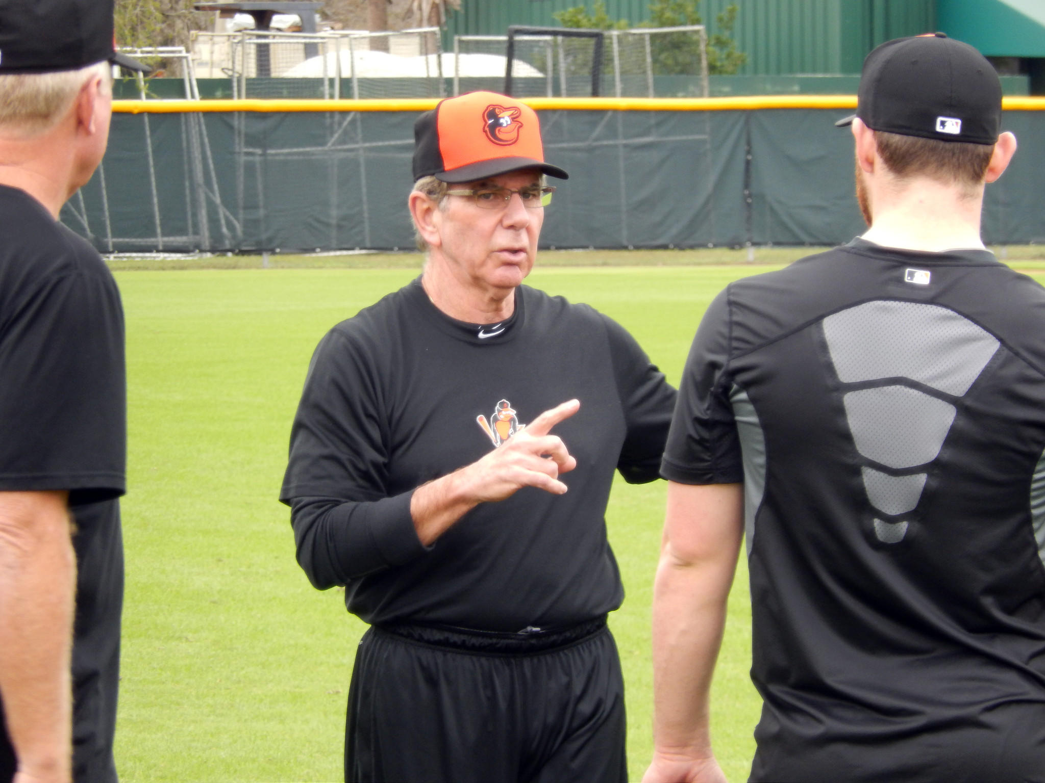 Orioles pitching coach Dave Wallace instructs his pitchers before they separate for station drills earlier this month in Sarasota, Fla.