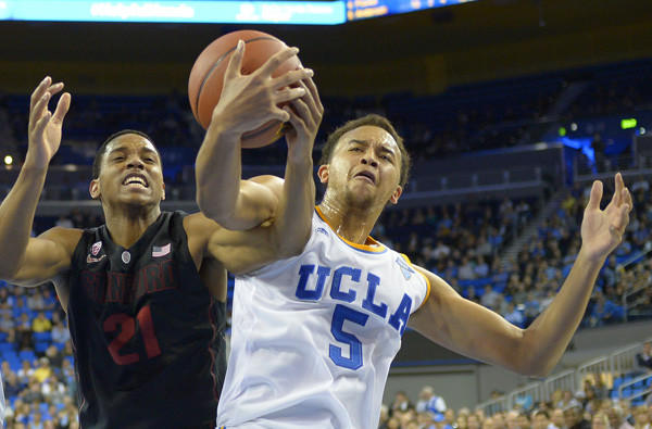 UCLA guard Kyle Anderson battles Stanford forward Anthony Brown for a rebound in a game Wednesday night at Pauley Pavilion.