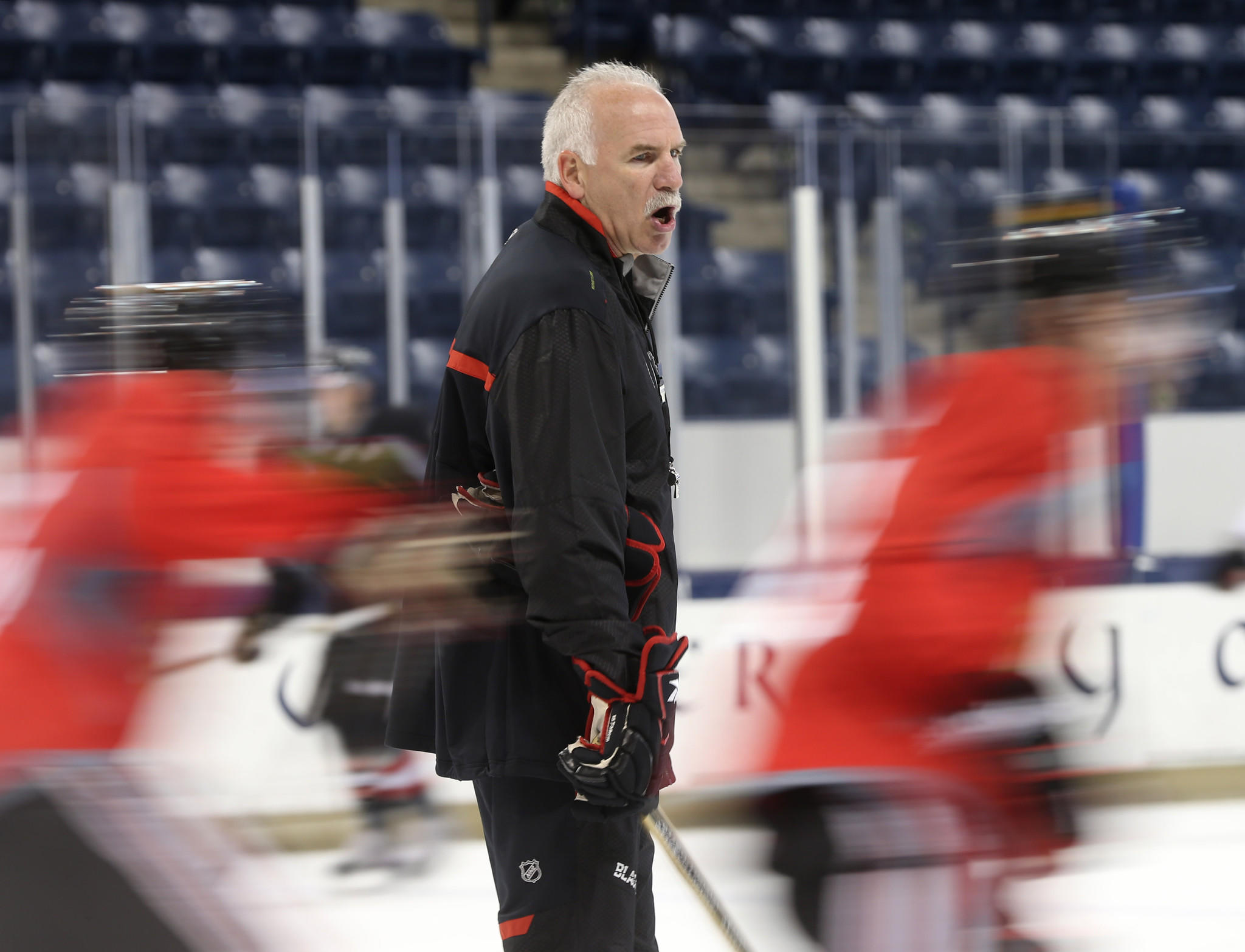 Chicago Blackhawks head coach Joel Quenneville runs practice Thursday, Sept. 12, 2013 at Notre Dame's Compton Family Ice Arena in South Bend.