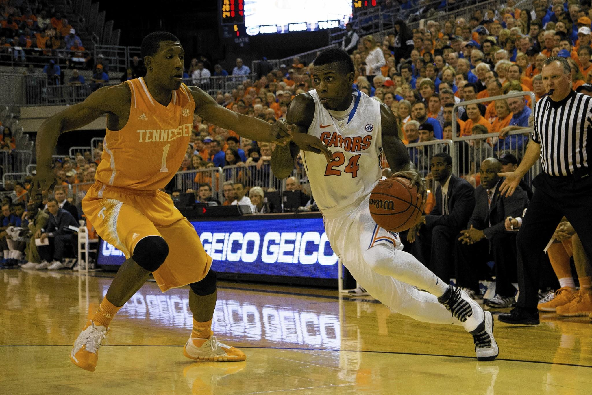Volunteers guard Josh Richardson defends Gators forward Casey Prather.
