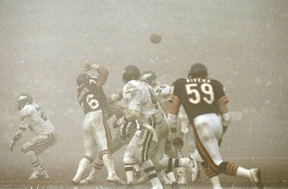 "Chicago Bears defenders Ron Rivera (59) and Steve McMichael (76) on the field against the Philadelphia Eagles at Soldier Field, on December 31, 1988. The game bacame known as ""Fog Bowl."""