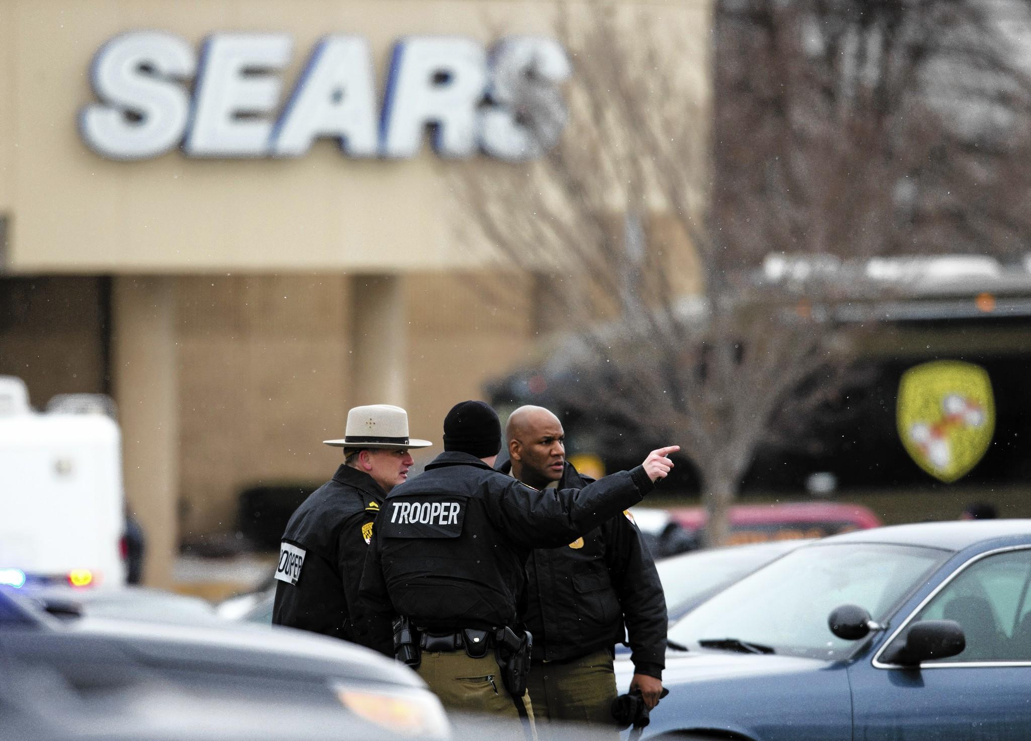 Law enforcement officers respond to the shooting at the Mall in Columbia, a shopping center in Columbia, Md.