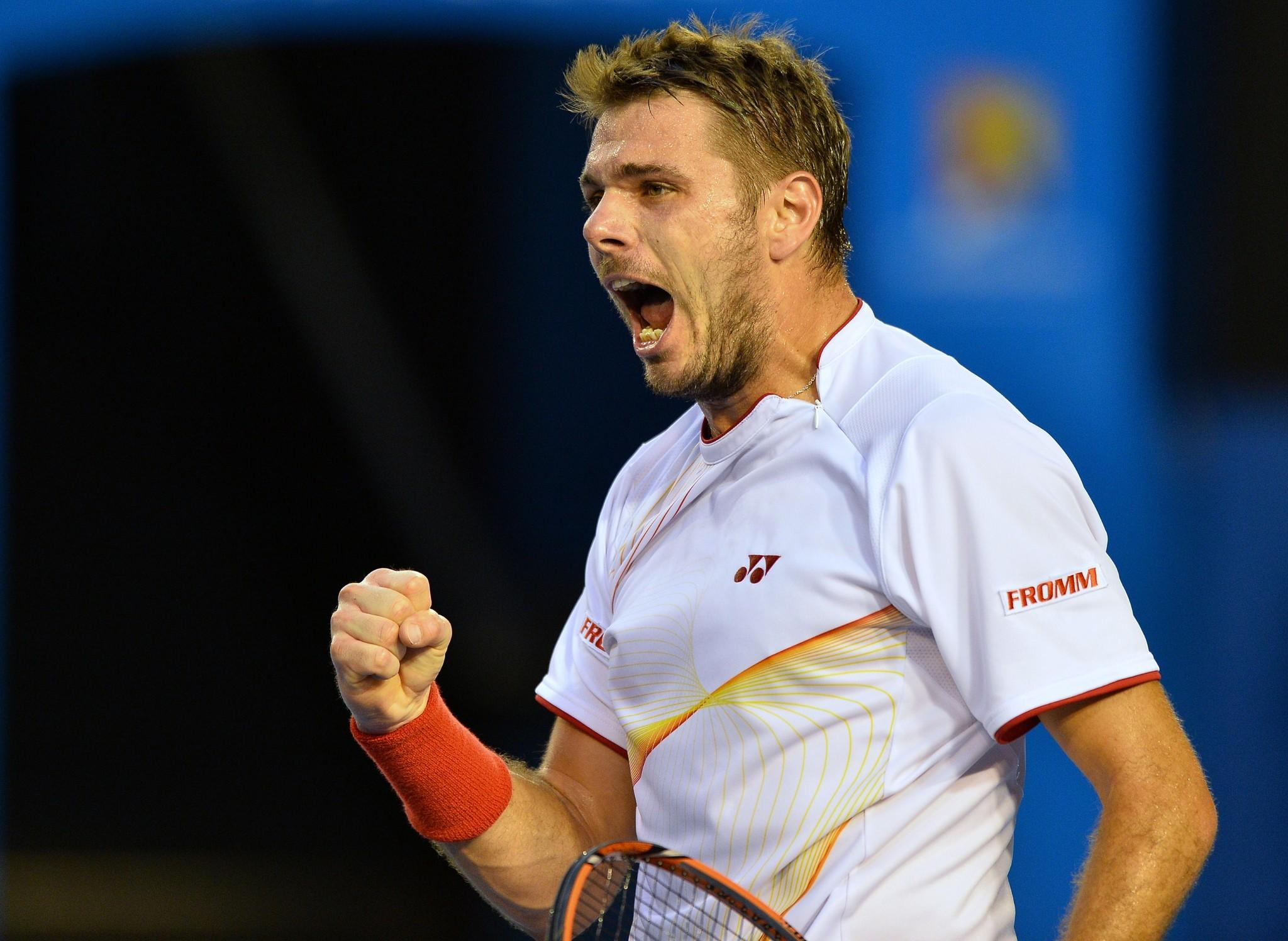 Switzerland's Stanislas Wawrinka reacts after a point against Spain's Rafael Nadal during the men's singles final.
