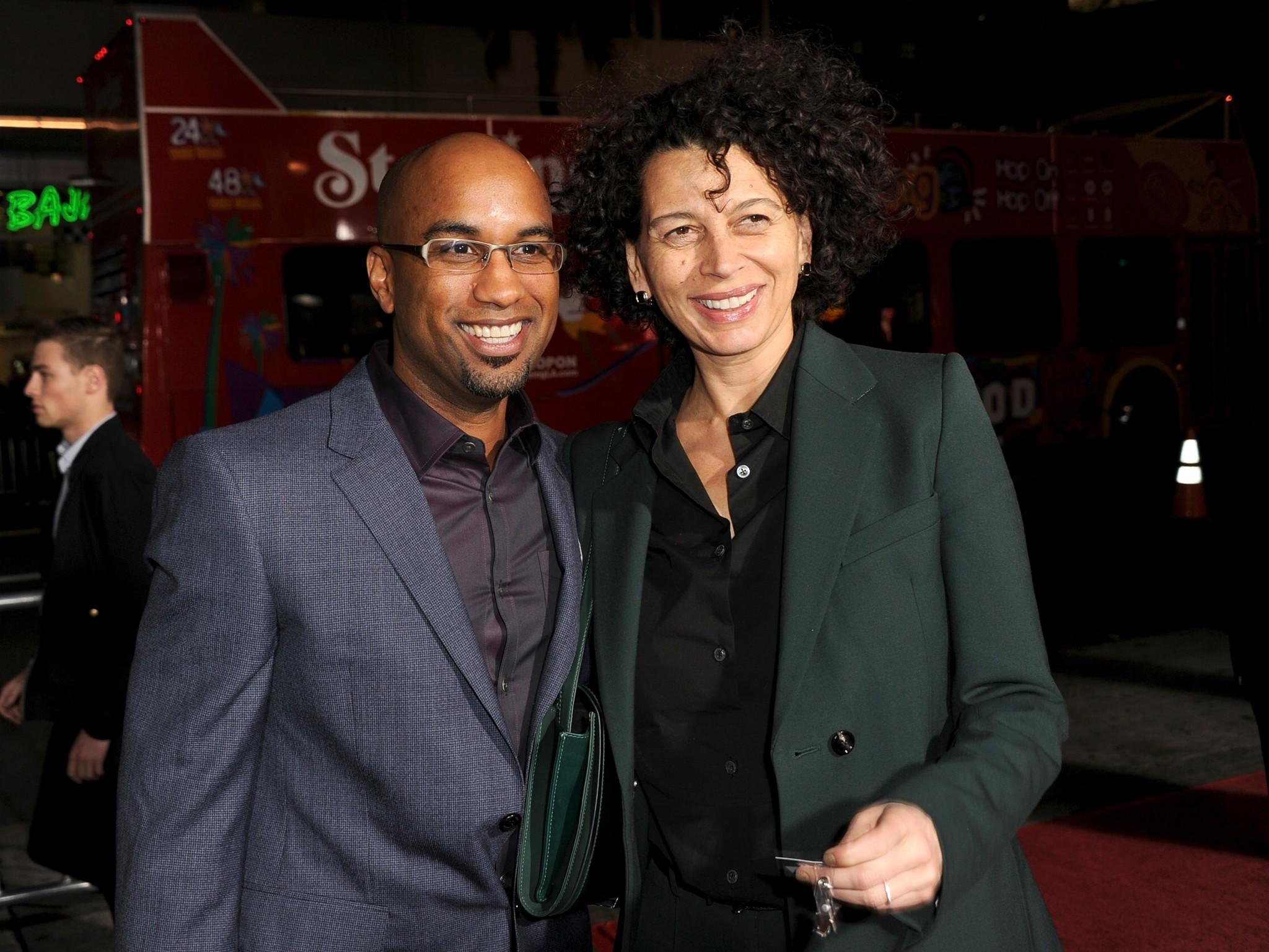 """Universal Pictures Chairman Donna Langley, right, attends the """"Ride Along"""" premiere Jan. 13 at the TCL Chinese Theatre in Hollywood with the film's director, Tim Story. Langley's contract has been extended through 2017."""