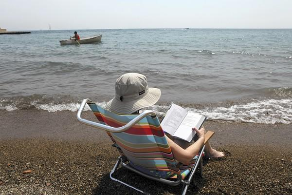It will be awhile before we can settle down at the beach with a good read, but the right book can get us halfway there.