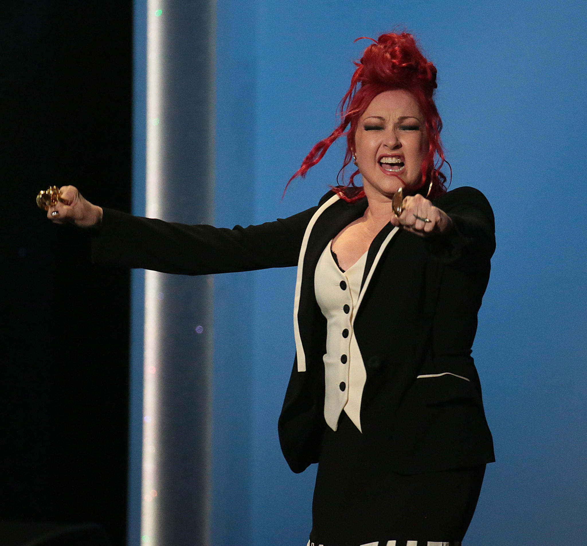 "Cyndi Lauper accepts the musical theater album award for ""Kinky Boots"" at the pre-telecast of the Grammy Awards on Sunday at the Nokia Theatre in Los Angeles."