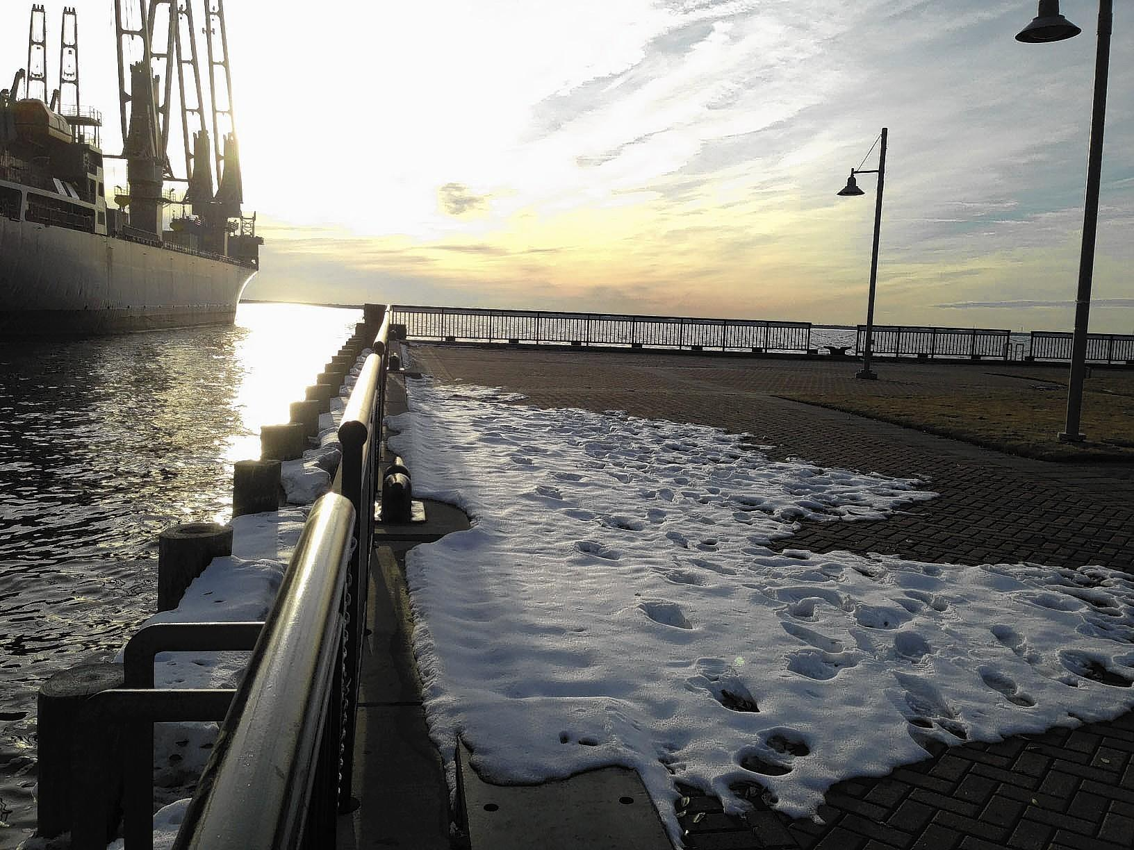 Patches of snow still remain on the walk at Victory Landing Park in Newport News Sunday.