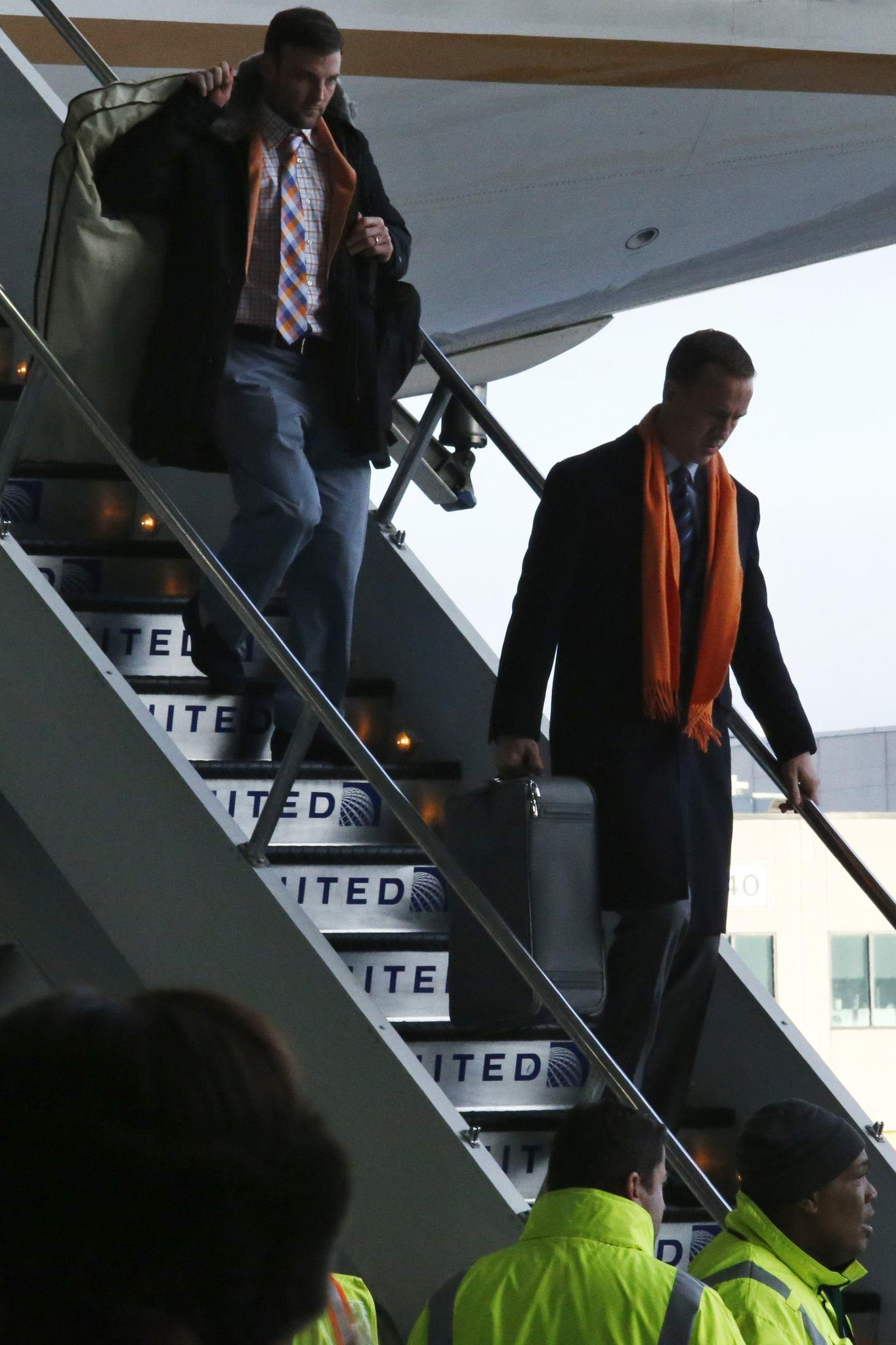 Broncos quarterback Peyton Manning, right, and his teammates arrive at Newark International Airport to prepare for Super Bowl XLVIII against the Seattle Seahawks.