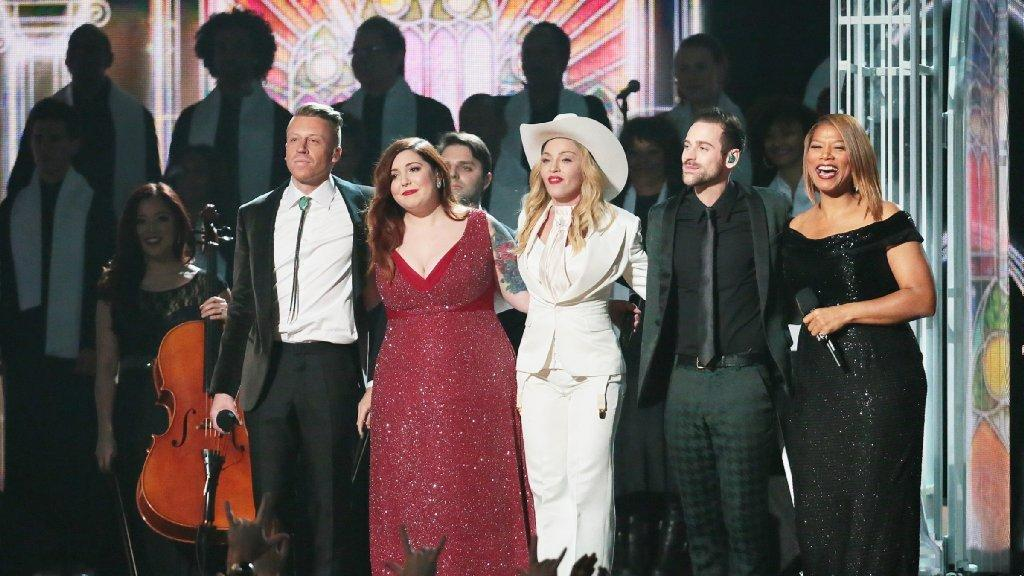 Couples are wed as Macklemore, left, performs with Mary Lambert, Madonna, Ryan Lewis and Queen Latifah at the 56th Grammy Awards. (Robert Gauthier / Los Angeles Times)