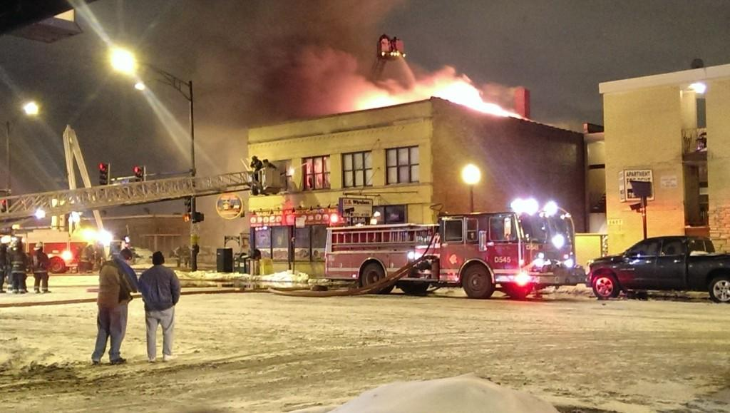 Crews fight a fire at the corner of Irving Park Road and Central Avenue in the Portage Park neighborhood.