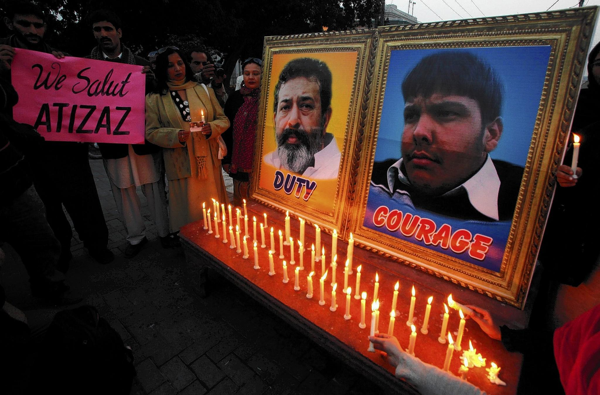 A vigil in Pakistan honors Aitzaz Hasan (photo on right), who was killed Jan. 6 after tackling a suicide bomber who was about to enter his school. The other photo shows Pakistani policeman Superintendent Chaudhry Aslam, who was killed in a separate bomb attack in January.