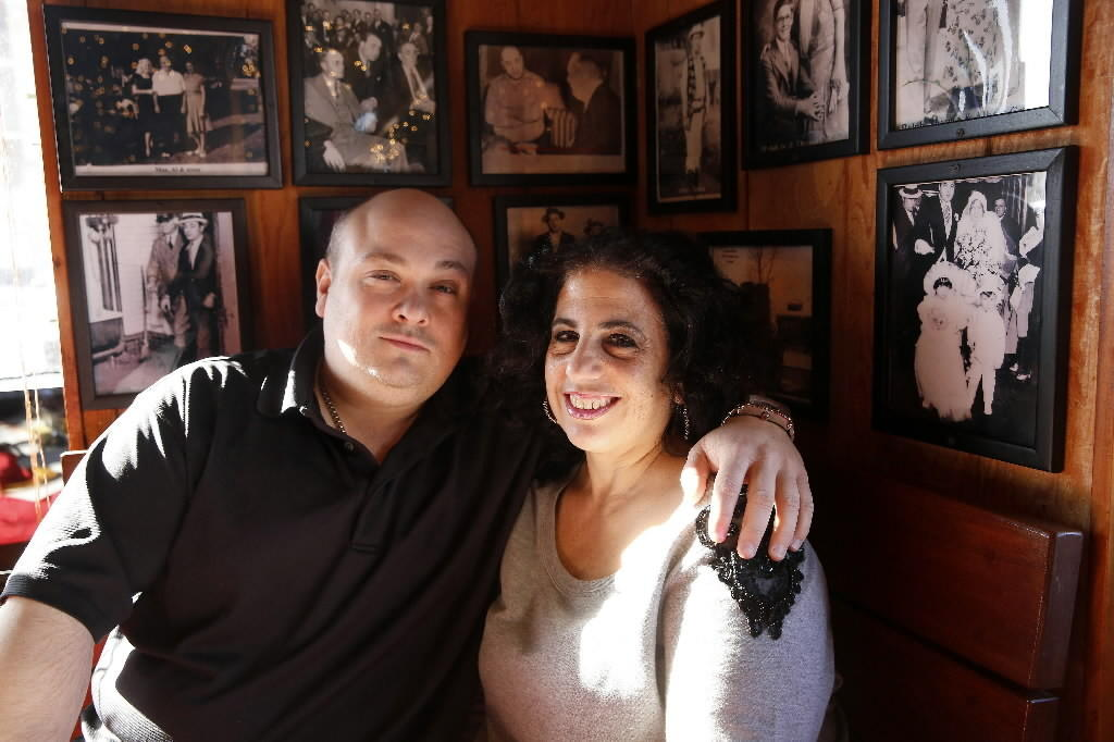 """The Capones"" stars Dominic Capone (left) and his mom Dawn Capone (right) at their Capone's restaurant in Lombard Jan. 23, 2014."