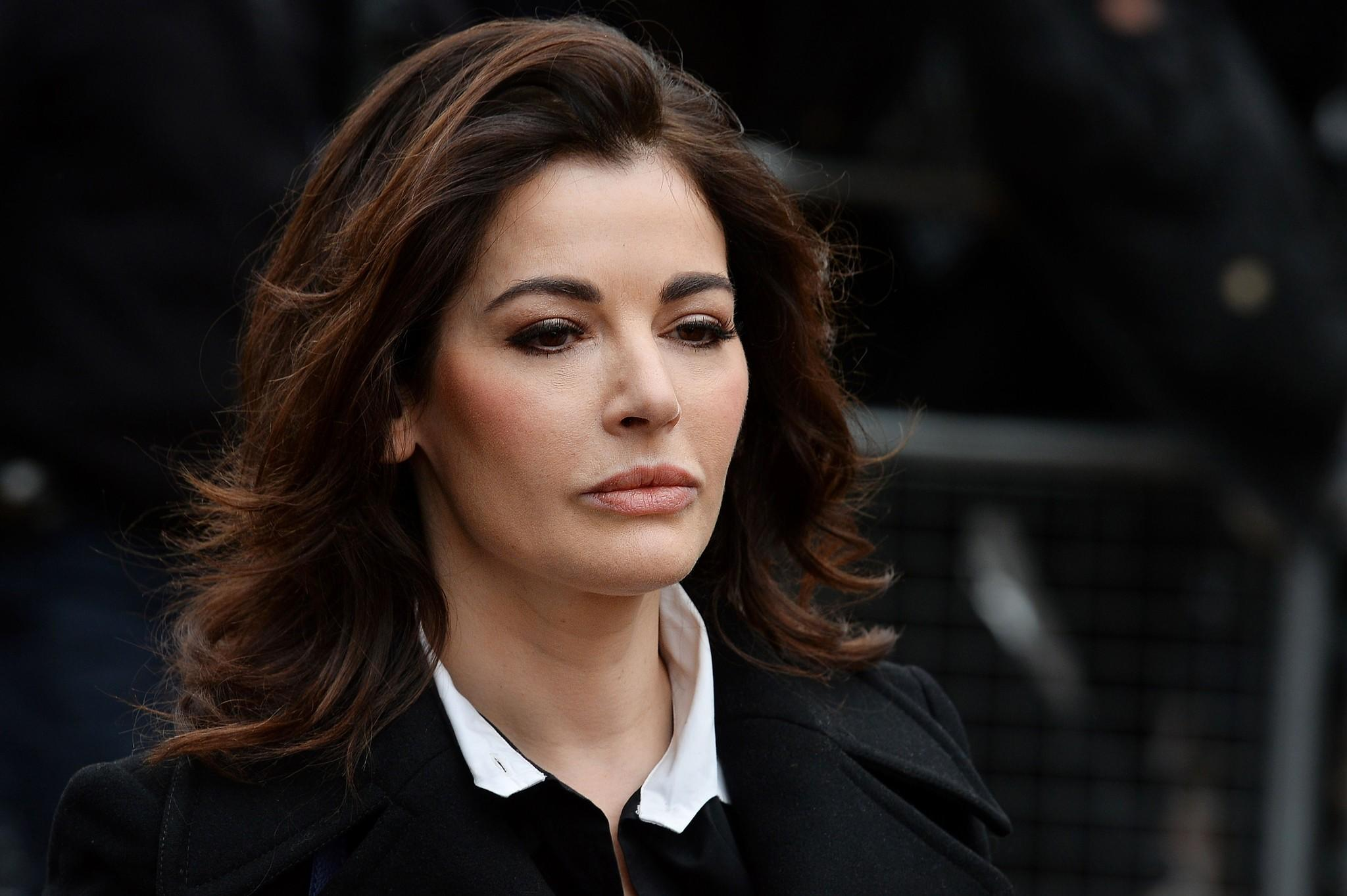 British television chef Nigella Lawson arrives at Isleworth Crown Court in west London.