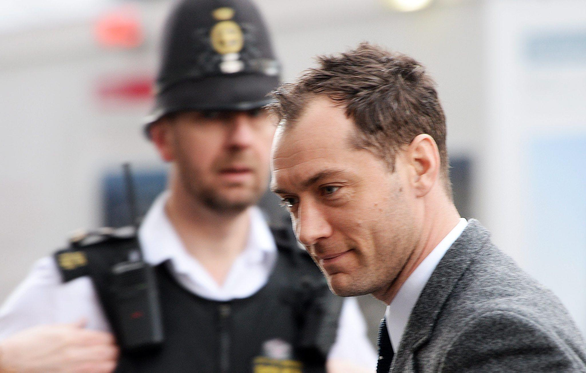 Jude Law arrives at the Old Bailey Criminal Court to give evidence in the 'News of the World' hacking trial in London.