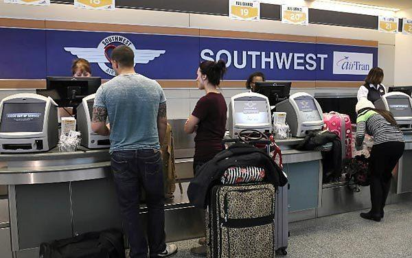 Southwest passengers check in at Midway Airport in January.