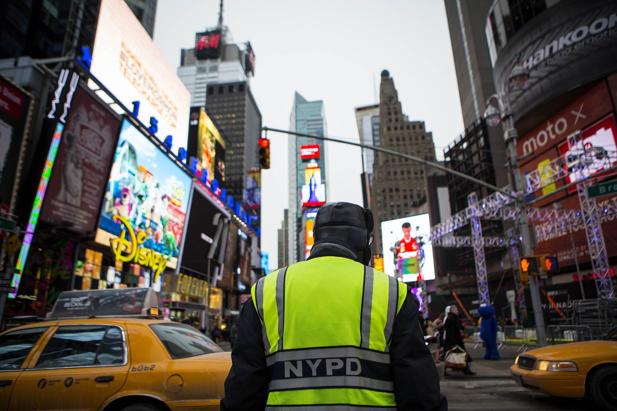 A police officer is seen in Times Square as preparations continue for Super Bowl XLVIII in New York January 26, 2014. New Jersey's MetLife Stadium will host the first outdoor, cold-weather Super Bowl February 2. As part of festivities, the NFL is sponsoring activities along 'Super Bowl Boulevard', located on Broadway between 34th and 47th streets in Manhattan.