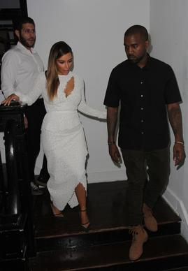 Kanye West and Kim Kardashian attend DuJour Magazine's event to honor artist Marc Quinn at Delano Beach Club on Dec. 4, 2013, in Miami Beach.