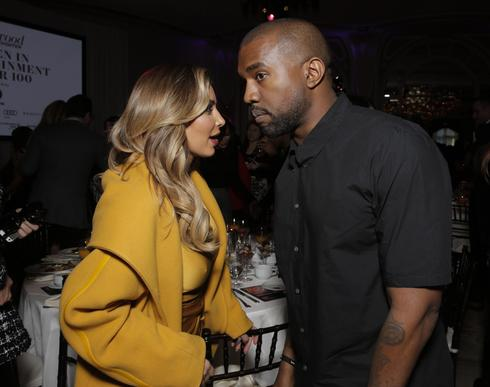 Kim Kardashian, left, and Kanye West attend the Hollywood Reporter's celebration of power 100 women in entertainment breakfast on Dec. 11, 2013, in Beverly Hills.