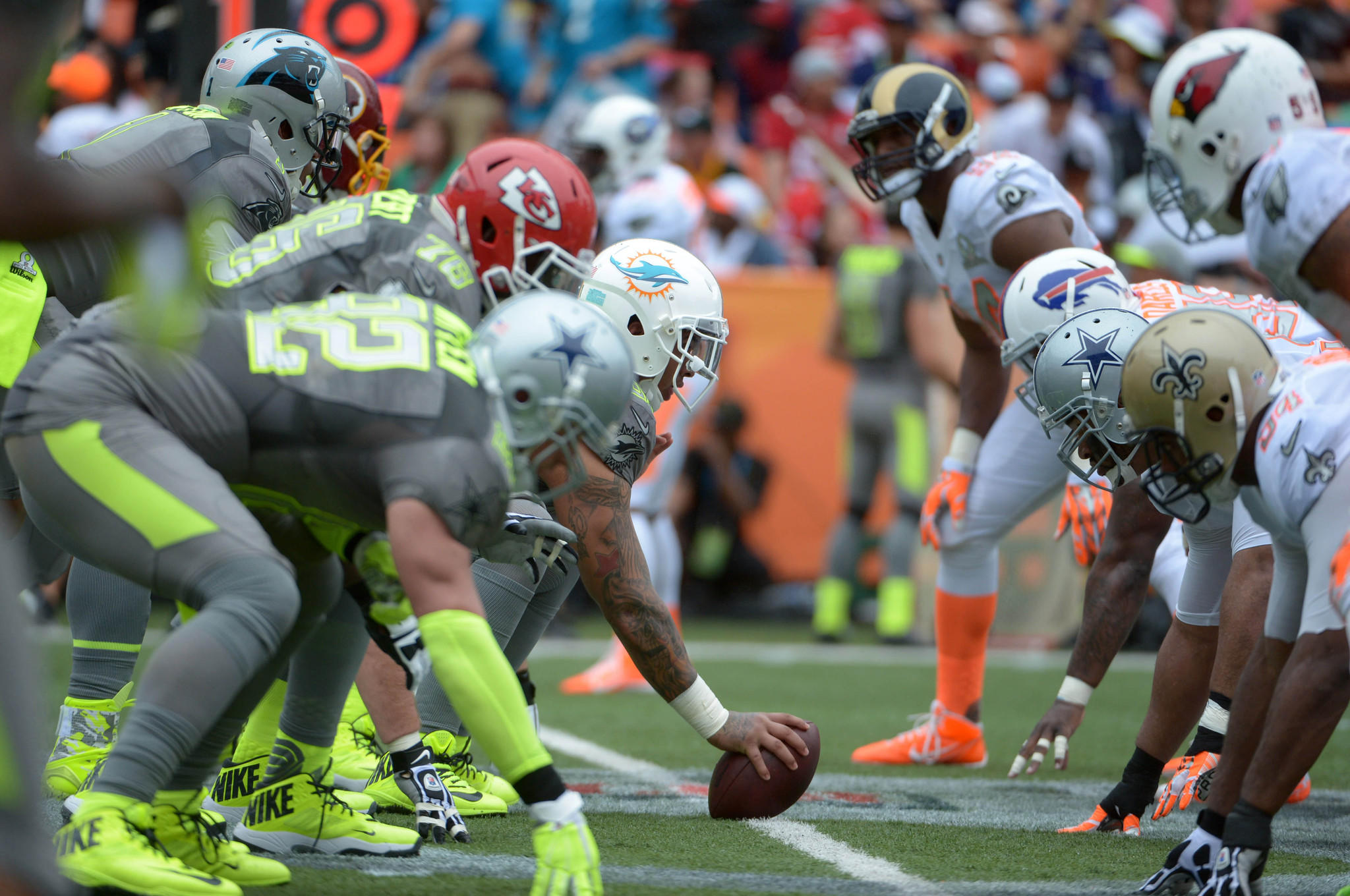 General view of the line of scrimmage as Team Sanders center Mike Pouncey of the Miami Dolphins snaps the ball during the 2014 Pro Bowl.