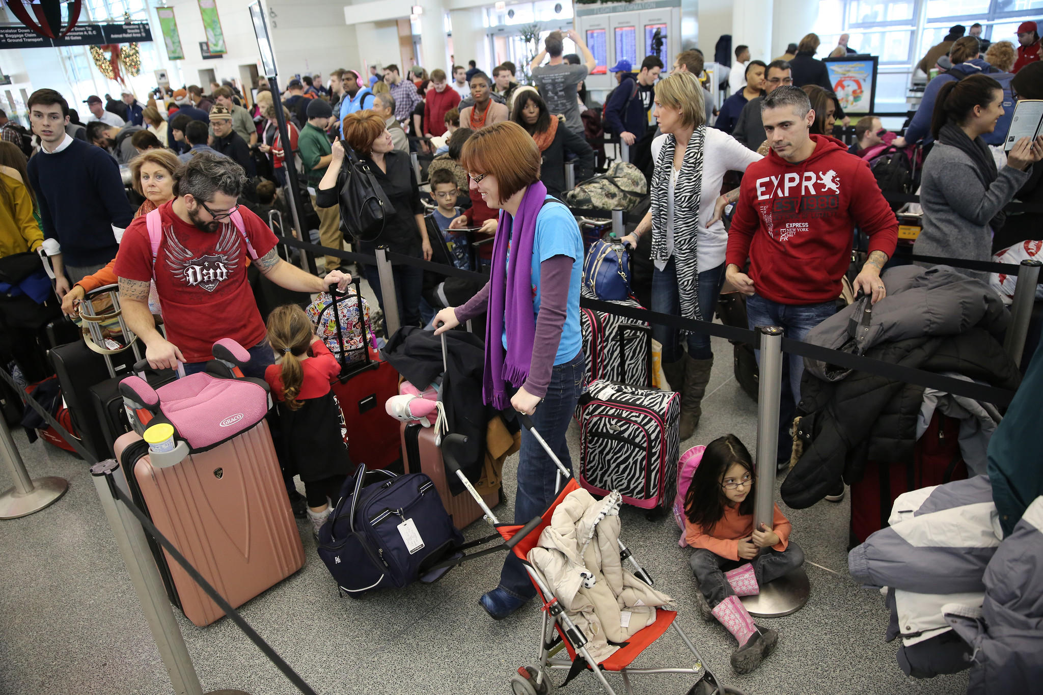 Hundreds of travelers wait in line for check in at Midway Airport, Friday, Jan. 3, 2014.