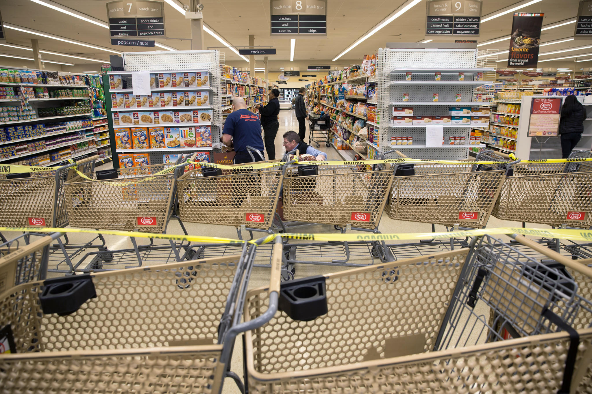 Caution tape and shopping carts block off areas during the transformation of a Dominick's grocery store into a new Jewel Osco store at 1340 S. Canal in Chicago, Tuesday, Jan. 14, 2014. The store will reopen on Thursday. (Alex Garcia/Chicago Tribune) B583458899Z.1 .OUTSIDE TRIBUNE CO.- NO MAGS, NO SALES, NO INTERNET, NO TV, CHICAGO OUT, NO DIGITAL MANIPULATION...