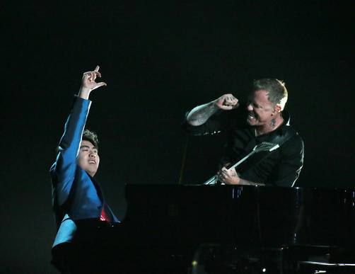 Lang Lang performs with Metallica at the 56th Grammy Awards.