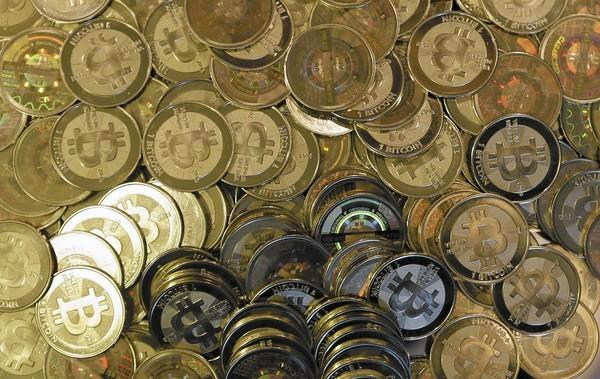 The federal government has locked up one of the biggest names in the bitcoin community in the latest crackdown on digital currencies and their illicit use. Above, bitcoin tokens are shown.
