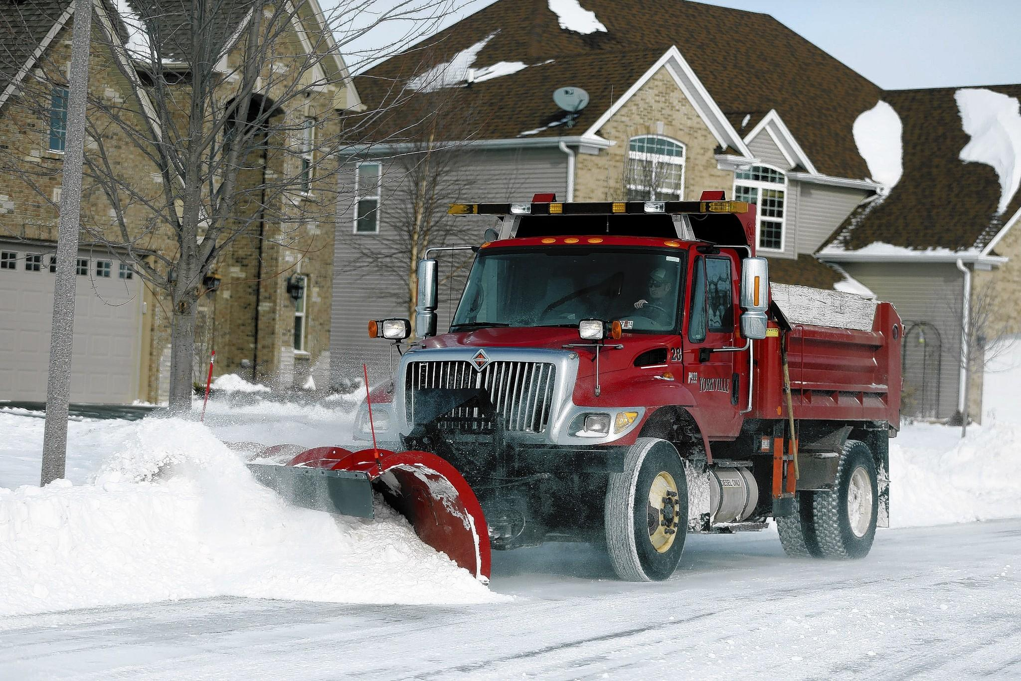 A snowplow works on a Yorkville subdivision Monday. Many communities are experiencing a salt shortage due to the rough winter.