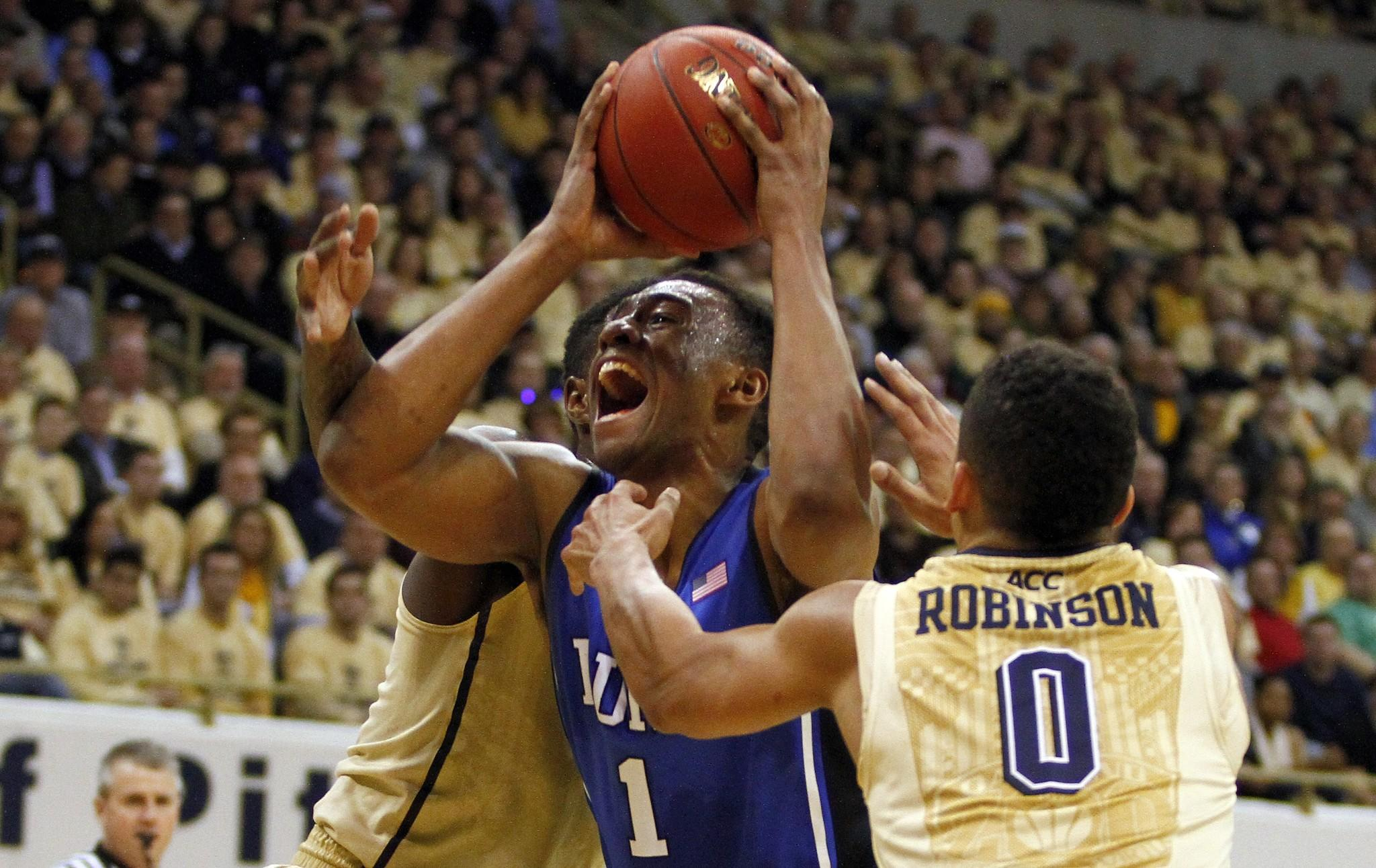 Duke's Jabari Parker drives to the hoop against Pitt's James Robinson.