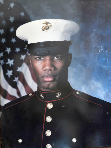 A photograph of Tyrone Brown in his Marine dress blues. Brown, who lived in East Baltimore, was killed by police officer Gahiji Tshamba outside Eden's Lounge at 15 W. Eager St in Mt. Vernon. His sister, La-Belle Scott, says her brother served in the Corps from 1998-2005.