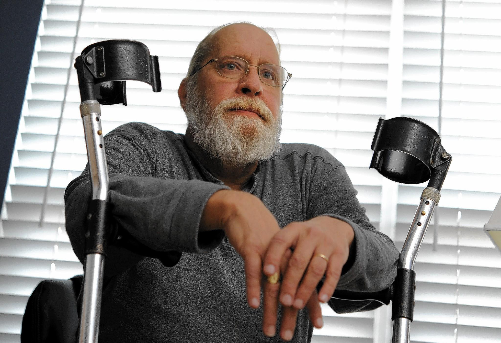 Barry Considine, 60, smokes marijuana to ease the pain of post-polio syndrome, the muscle weakness that afflicts polio victims as they age and now requires him to use a wheelchair.