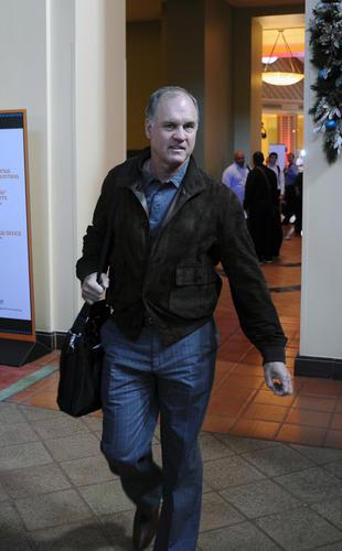 Philadelphia Phillies manager Ryne Sandberg leaves Major League Baseball's winter meetings in Lake Buena Vista, Fla.