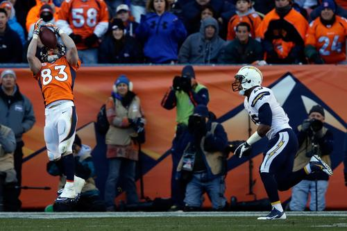 Denver Broncos wide receiver Wes Welker, left, catches a touchdown pass against the San Diego Chargers in the second quarter of the AFC divisional playoff game at Sports Authority Field at Mile High.