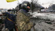 Ukraine prime minister resigns; parliament cancels anti-protest laws