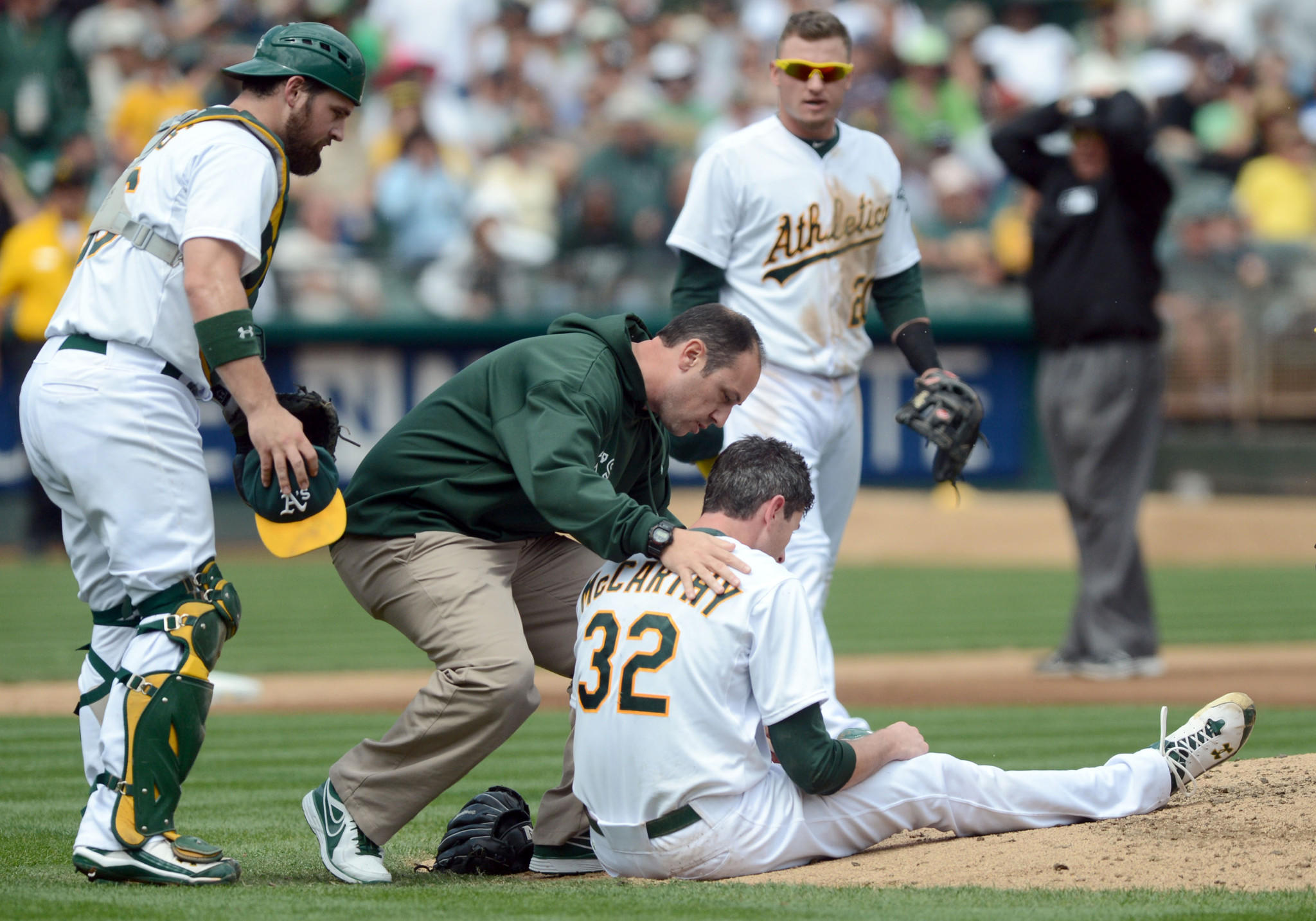 Pitcher Brandon McCarthy, then with Oakland, is attended to after being hit in the head with a line drive by the Angels' Erick Aybar during a 2012 game.