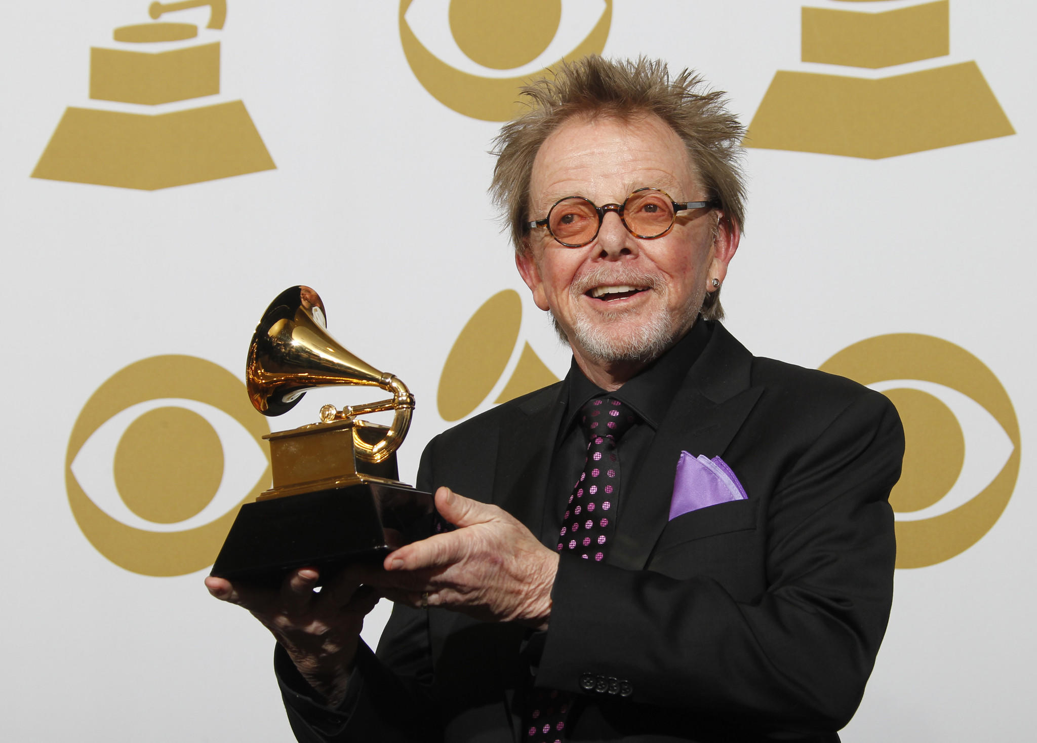 "Paul Williams, a collaborator on Daft Punk's album ""Random Access Memories,"" shows off his Grammy for album of the year."