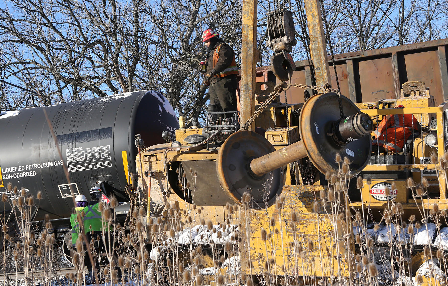 A Canadian National Railway worker works at the site of a train derailment in Mundelein. The train derailed near Winchester Road in Mundelein shortly before 1 a.m. Tuesday, according to railroad officials and police. The car was carrying plastic pellets.