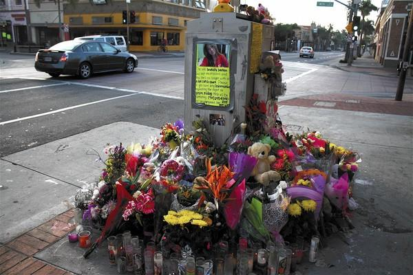 The shrine for Kim Pham in Santa Ana at the spot where she was attacked.