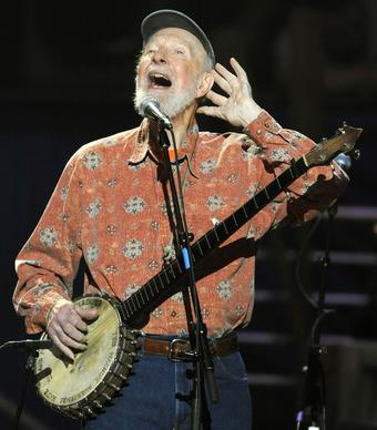 Music legend Pete Seeger, who usually performed for the benefit of others, sings and plays banjo here during a concert marking his 90th birthday at Madison Square Garden in New York.
